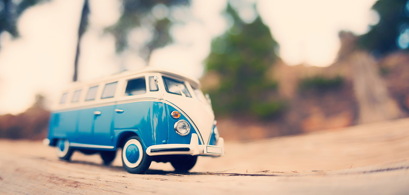 Miniature travelling vintage van. Color tone tuned macro photo