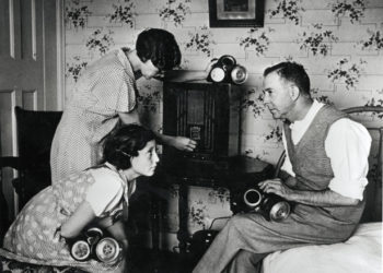 World War Two, England, 1938, The family at home, tuning in to hear the news on the radio news, They have gas masks at the ready  (Photo by Popperfoto/Getty Images)